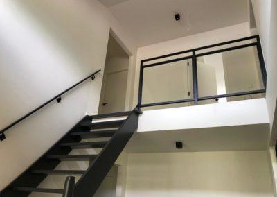 Stalen trapleuning en traphek